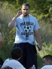 Ahmed Kandil talks to Parsippany Hills at halftime in 2007, his first season as head coach.