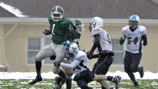 Christ School's Marcellos Allison and the Greenies thumped Asheville School on a snowy day in Arden.
