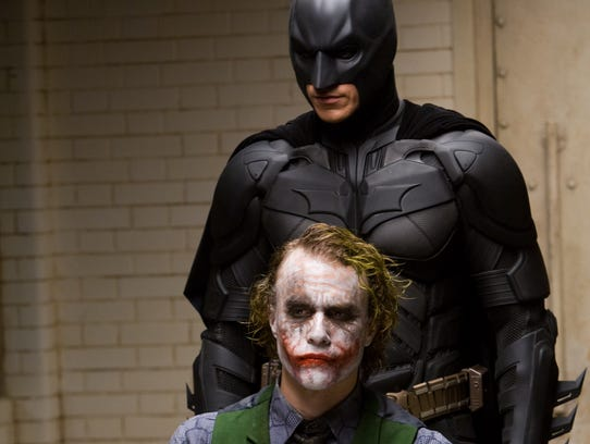 Christian Bale (top) was the titular Caped Crusader