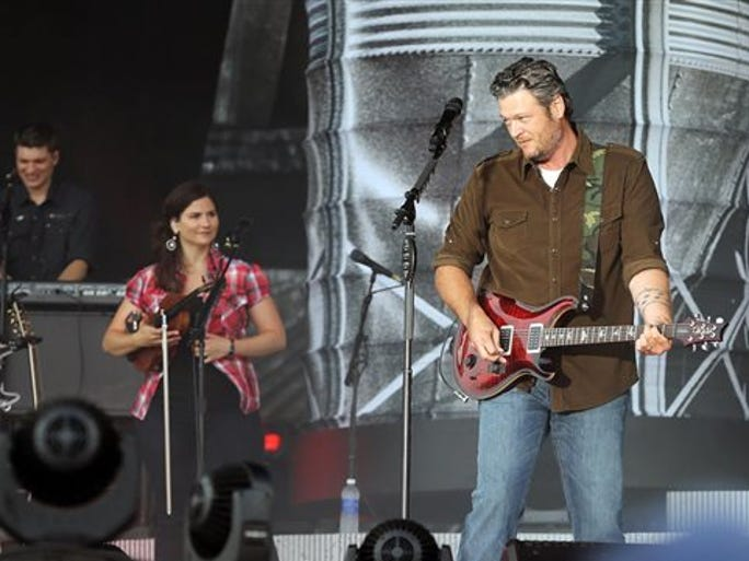 Blake Shelton performs on stage during a free beach concert in Atlantic City, N.J., Thursday, July 31, 2014.