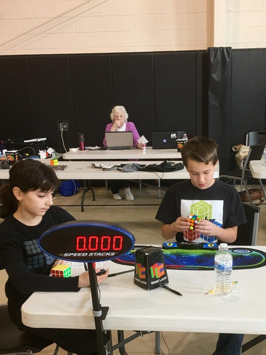 Competition Organizer TOMMY CHERRY attempts a solve