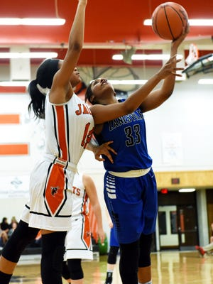 Zanesville's Tasia Staunton shoots from the block during third-quarter action of the Lady Devils' 44-31 win against Mount Vernon. Staunton returned to the lineup after missing a game with a concussion.