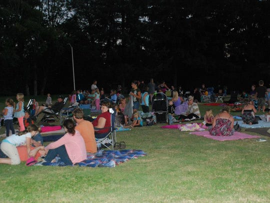 Viewers enjoy a free movie in the park at the Stayton Public Library