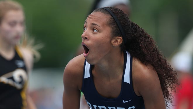 Jalynn Roberts-Lewis of Roosevelt is stunned at her time in the 200 meters. She ran 24.45 seconds, .2 behind the 1985 meet record held by Natasha Kaiser-Brown.