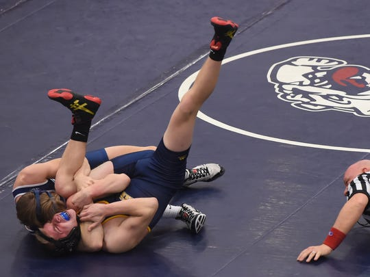 West York's Luke Stine pins Eastern York's Dillon Mealey in the 145 lb class during the Bulldog's 49-24 victory on Tuesday, Jan. 10, 2017.