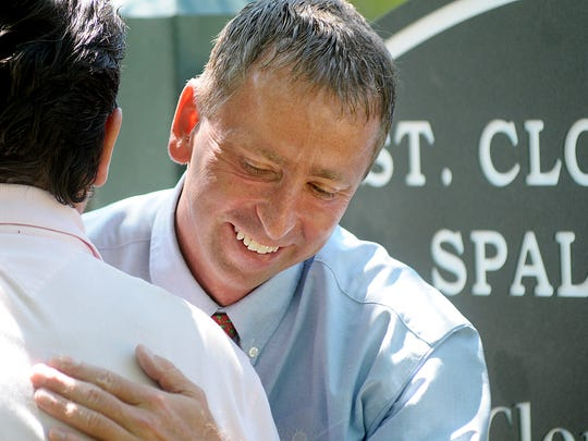 St. Cloud Mayor Dave Kleis hugs Spalt, Germany, Mayor Udo Weingart during a surprise ceremony in 2009.