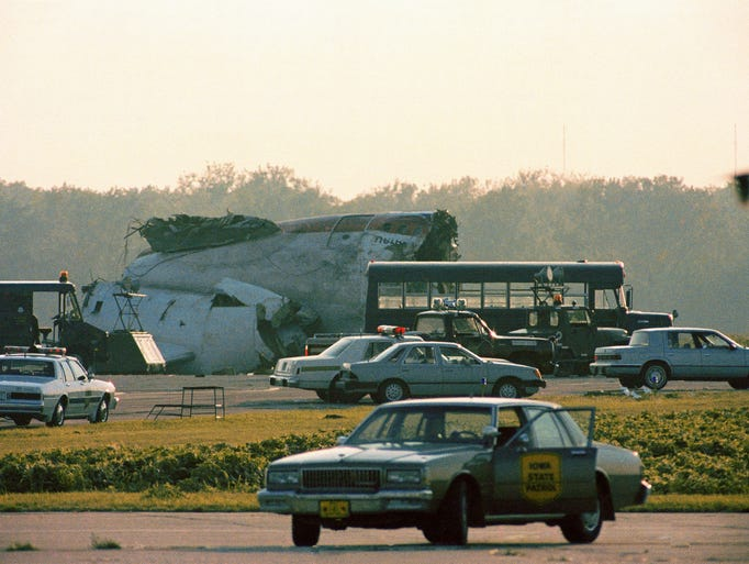 A section of the United Airlines DC-10 stands among emergency vehicles after crashing while trying to make an emergency landing in Sioux City, Iowa, Wednesday, July 19, 1989.