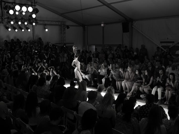 MIAMI BEACH, FL - JULY 18:  (EDITORS NOTE: Image has been converted to black and white)  A model walks the runway during the Dolores Cortes show at Mercedes-Benz Fashion Week Swim 2015 at The Raleigh on July 18, 2014 in Miami Beach, Florida.  (Photo by Andrew H. Walker/Getty Images)