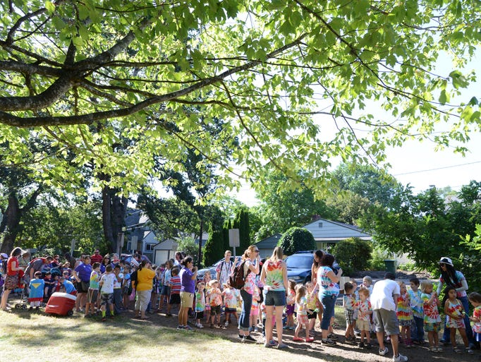 Participants wait for the Children's Parade to begin at the Salem Art Fair at Bush's Pasture Park on Friday, July 18, 2014.