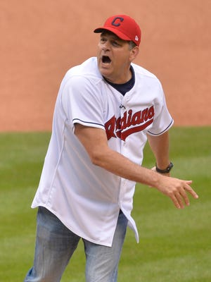 Jul 9, 2015; Cleveland, OH, USA; ESPN radio personalities Mike Greenberg (L) and Mike Golic (R) throw out ceremonial first pitches at Progressive Field.