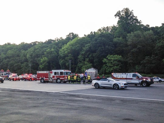 The Yonkers Fire Department, Police Department and Emergency Services Unit respond to the scene of a tanker truck and car collision on the state Thruway in Yonkers on Wednesday morning.