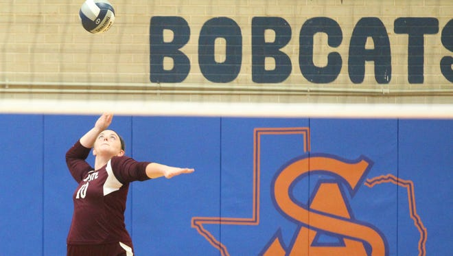 Bronte High School's Cassidy McWright serves during the Region I-1A volleyball final against Klondike, Saturday, Nov. 11, 2017, at Babe Didrikson Gym at Central High School.