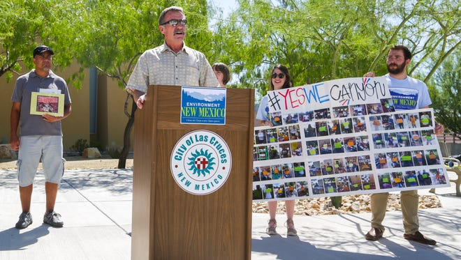 Executive Director of the Southwest Environmental Center Kevin Bixby speaks out against mining at the Grand Canyon in front of Las Cruces City Hall as members of environmental group Environment New Mexico hold up a banner, Wednesday, August 24, 2016.