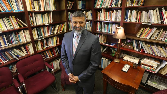 Chacku Mathai, President and CEO, Mental Health Association, in the library at the 320 North Goodman Street center in Rochester Wednesday, March 7, 2018.