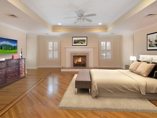 The master bedroom features hardwood floors and a fireplace.
