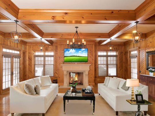 The great room offers customized beamed wood  ceilings.