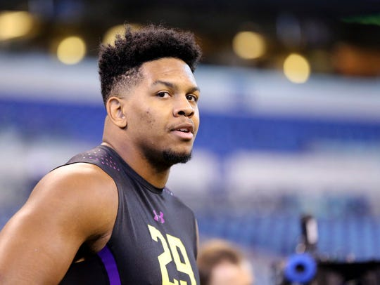UTSA defensive lineman Marcus Davenport watches at