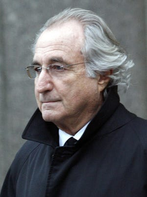 Ponzi scheme mastermind Bernard Madoff leaves Manhattan federal court in New York in January 2009.