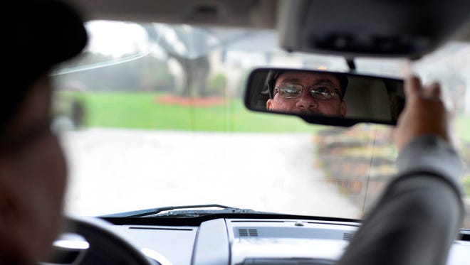 Edward Creelman, a Spring Garden Township man who has been an Uber driver for four months, adjusts his review mirror Dec. 30.