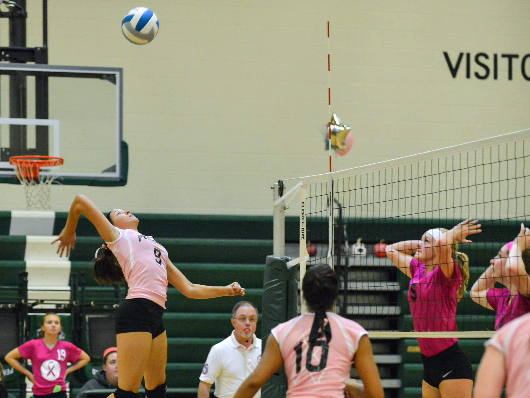 Pennfield's Shelby Smyers delivers the game winning kill Wednesday night.