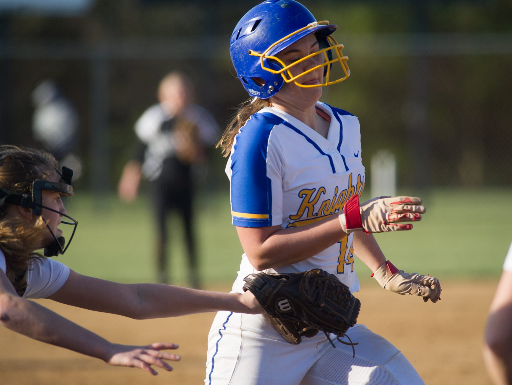 Sussex Tech's catcher Shannon Lord (7) tags out Sussex Central's Kasie Simpson (14) as she runs to home plate.