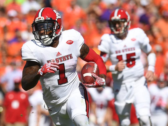 North Carolina State fullback Jaylen Samuels (1) carries against Clemson during the 1st quarter on Saturday, October 15, 2016 at Clemson's Memorial Stadium.