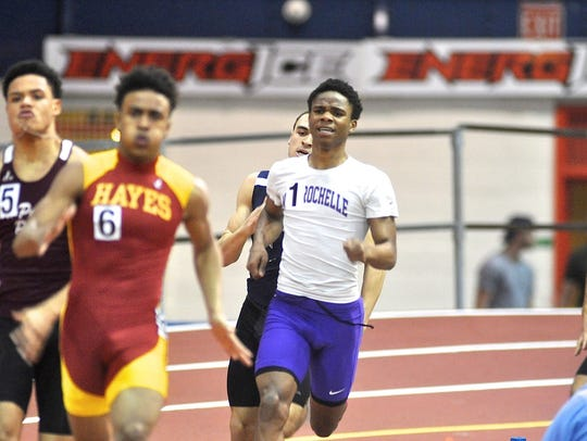 New Rochelle's Jessie Parson competes in boys 400 during