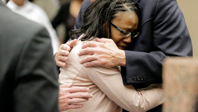 Wakesha Ives, 39, falls into her attorney's arms after hearing the sentence that was handed down by 384th District Judge Patrick Garcia on Thursday.