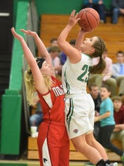 Norfork's Kinley Stowers attempts to draw a charge Tuesday night at Valley Springs.