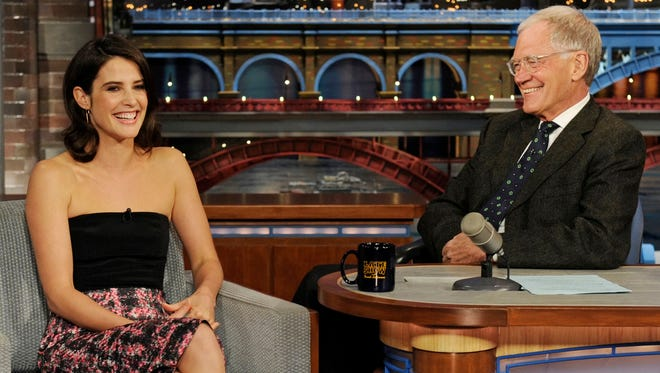 """In this March 31, 2014 photo, actress Cobie Smulders from the CBS comedy series """"How I Met Your Mother,"""" talks to host David Letterman about the series finale. Smulders is celebrating her birthday on April 3."""