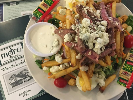Yes, you can have fries on a salad. The Pittsburgh steak salad at Metro Diner locations in and around Indianapolis is a layered mound of garden salad, medium-rare prime rib strips, blue cheese and – wait for it -- french fries.