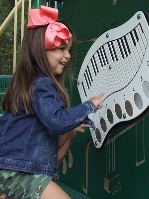 Bailey Gothard makes beautiful music on the keyboard that is part of the new playground at Dover City Park off of Colson Road.