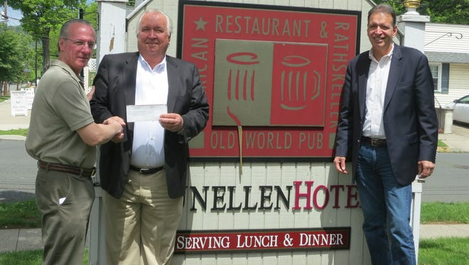 Rick Hendricks of The Dunellen Hotel presents Joe and Tom Boniakowski  of ERA Boniakowski Real Estate a check after 2016's MDA Dine and Donate Day.