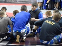 Northern Lebanon coach Rusty Wallace talks to his wrestlers minutes before the state championship bout at the Giant Center Saturday afternoon.
