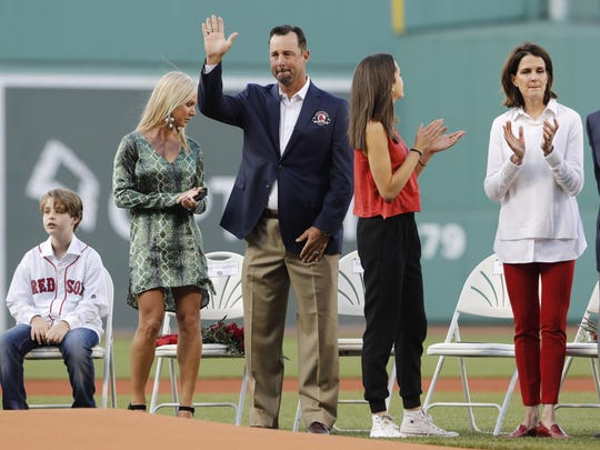May 20, 2016; Boston, MA, USA; 2016 Red Sox Hall of Fame inductee Tim Wakefield waves to the crowd before throwing out the first pitch with fellow inductees Larry Lucchino and Jason Varitek (not pictured) before the start of the game against the Cleveland Indians at Fenway Park. Mandatory Credit: David Butler II-USA TODAY Sports