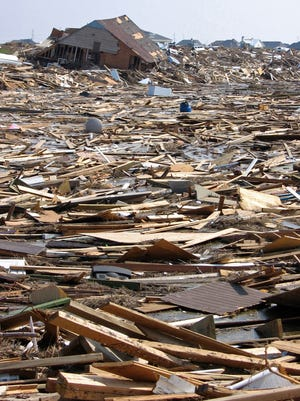 The reminants of decimated homes blanket the ground in Slidell, Louisiana, two weeks after Hurricane Katrina made landfall in 2005.