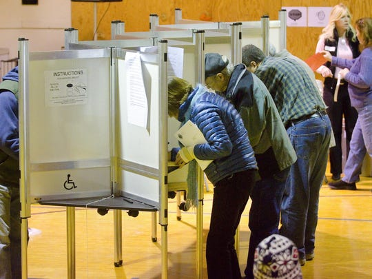 Voters fill out their ballots before the start of the Jericho town meeting on Tuesday. Jericho residents will vote Tuesday on whether to require presidential candidates to disclose their tax returns to get on Vermont ballots.