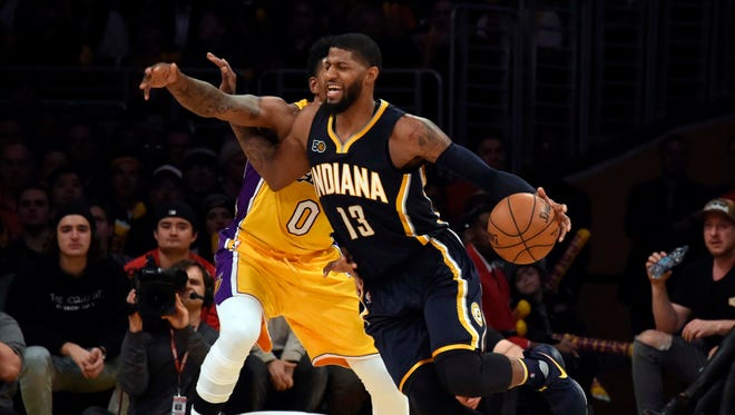 Indiana Pacers forward Paul George (13) drives to the basket against Los Angeles Lakers guard Nick Young (0) during the fourth quarter at Staples Center.