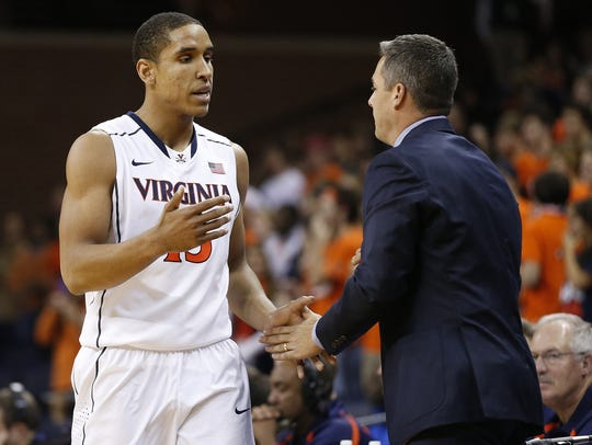 Tony Bennett (right) was Malcolm Brogdon's coach and