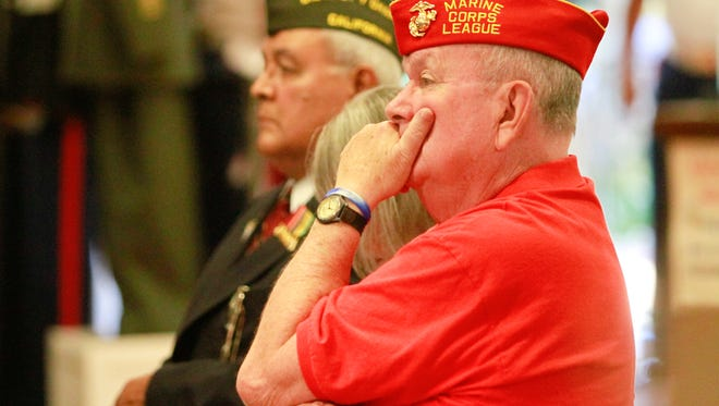 Dick Jennings, chairman of the Marine Corps League, reacts the during Friday's POW/MIA  program Friday evening in Simi Valley. A ceremony also was held in Ventura.