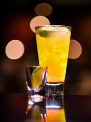 A passion sunrise cocktail, prepared by three-time flair bartending champion Jun Navarro, at the TGI Fridays, Guam restaurant in Tumon on Thursday, July 19, 2018.