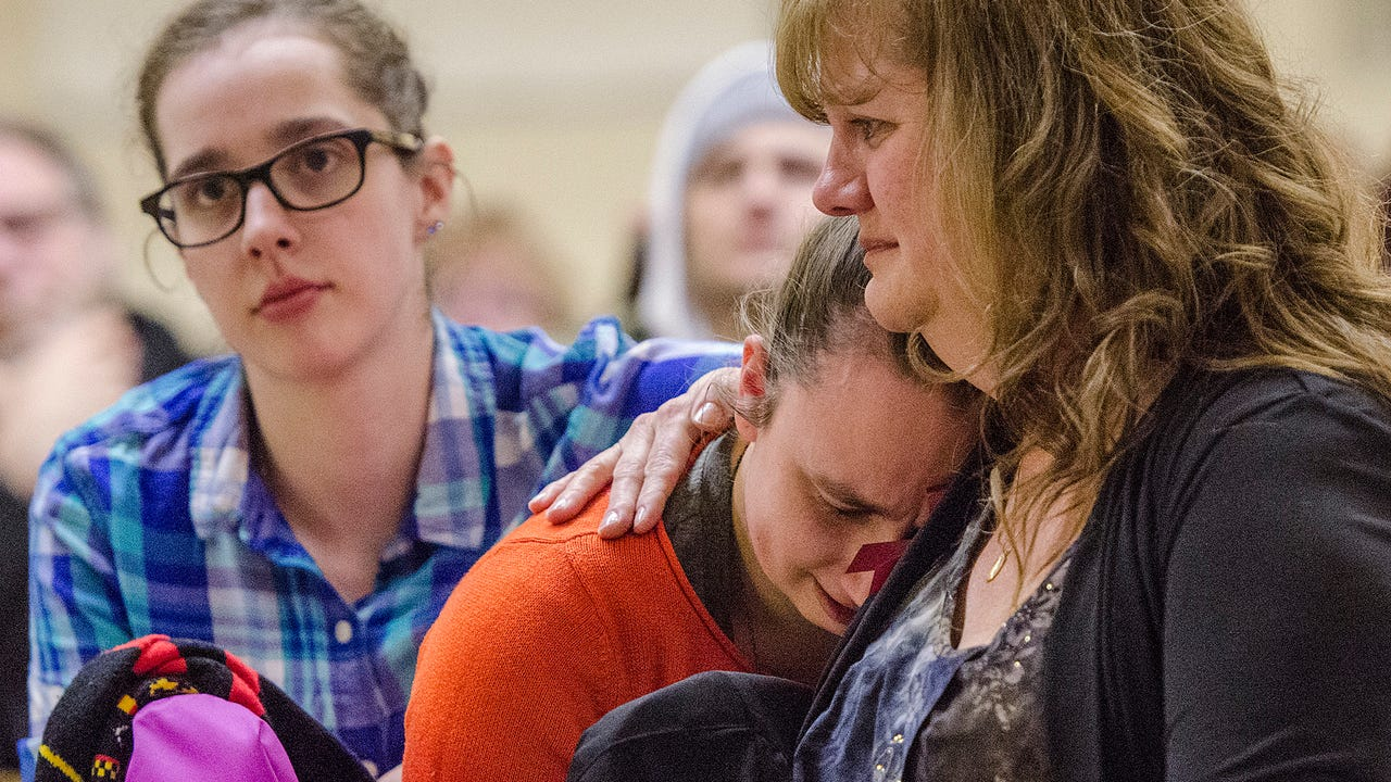 Friends, family and strangers came together Thursday for the vigil.