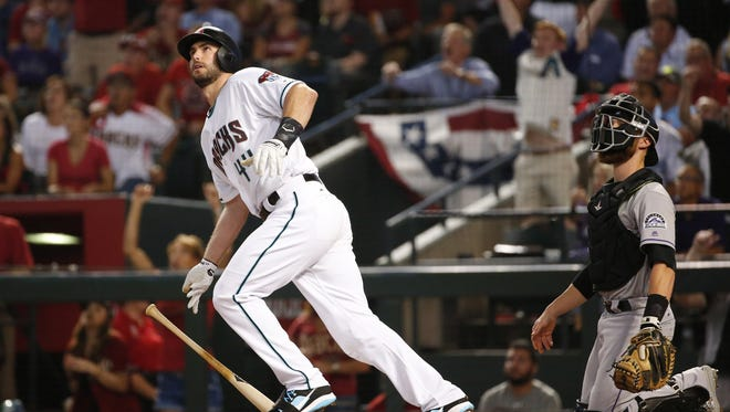 Arizona Diamondbacks first baseman Paul Goldschmidt (44) watches his three-run home run against the Colorado Rockies during the first inning of the National League wild card game at Chase Field in Phoenix, Ariz. October 3, 2017.