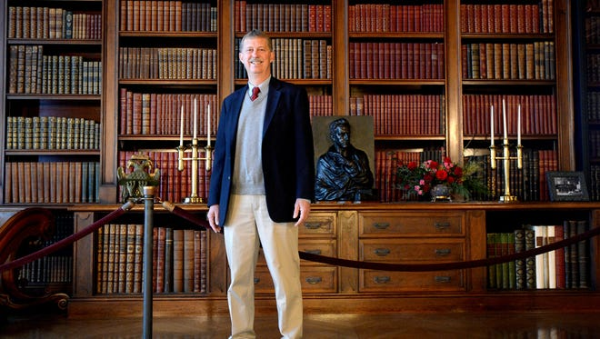 Bill Cecil, great grandson of George Vanderbilt, stands in the grand library of the Biltmore House on Friday. Cecil has been CEO of Biltmore Co. for 20 years keeping the family business as well as the famous estate running.