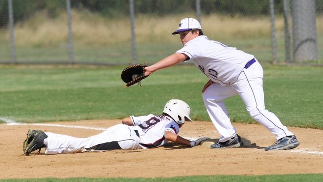 Wylie Intermediate first baseman Ryan Price reaches to catch a pick-off attempt as Oil Belt's Bryce Burnett dives back to the bag during Wylie's 15-3, five-inning win against Oil Belt in the Texas West state tournament on Saturday, July 14, 2018.