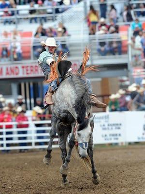 Evan Jayne from Marseilles, France rides bareback on Friday night at the 2015 California Rodeo Salinas.