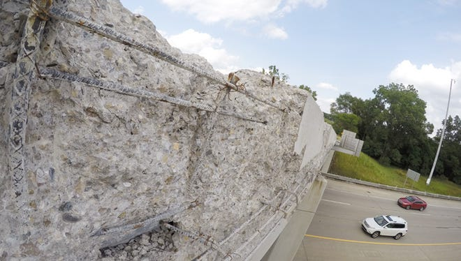 Crumbling concrete on the Flint Road overpass over I-96 in Brighton Township has some motorists concerned. Photo taken Tuesday, July 11, 2017.