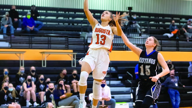 Maycee Anderson (13) goes up for a lay up against Rock Creek on Friday night at Augusta HS. The senior scored 14 ponts to lead the Orioles in the loss.