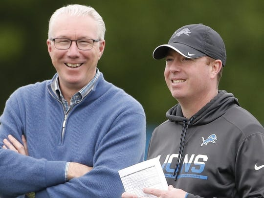 Detroit Lions team President Rod Wood, left, and General Manager Bob Quinn watch drills at the team's NFL football practice facility, Tuesday, May 21, 2019, in Allen Park, Mich. (AP Photo/Carlos Osorio)