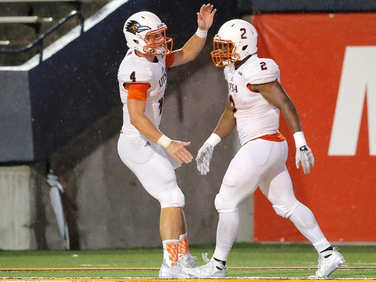 UTSA quarterback Blake Bogenschutz, left, and running back Jarveon Williams celebrate after a touchdown Saturday against UTEP at the Sun Bowl.